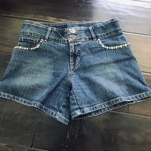 Designer jean shorts with studs by Cache Boutique